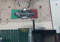 The Ravioli House Review Sign over the back door